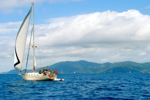 a sailboat passes by while out on the waters of Virgin Gorda